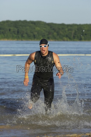 a male athelete running out of