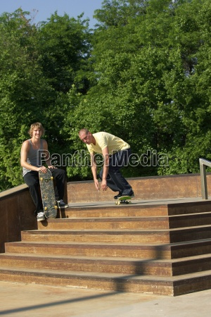 two male skateboarders doing tricks at