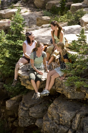 four women take a break to