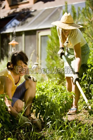two women socialize while working in