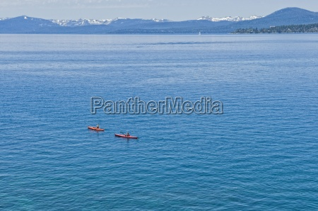 a pair of kayakers is out