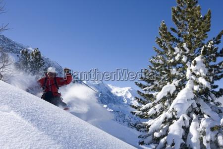 a man skiing some fresh snow