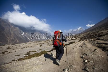 a trekker hikes off towards the