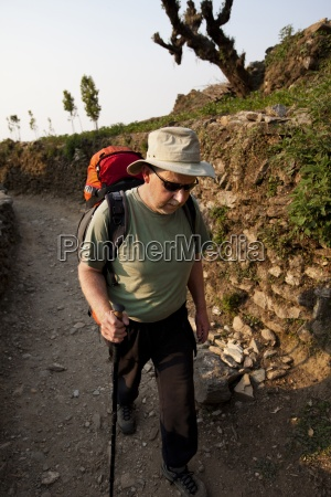 a trekker puts his head down