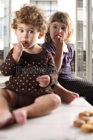 sisters eat cookies