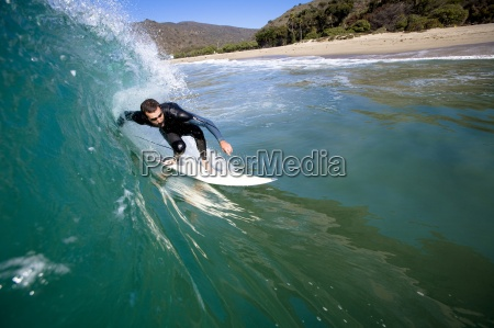 a male surfer stalls for a