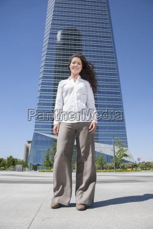 businesswoman in front of skyscrapers