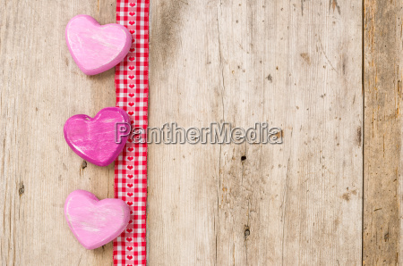 gift ribbon with hearts against rustic