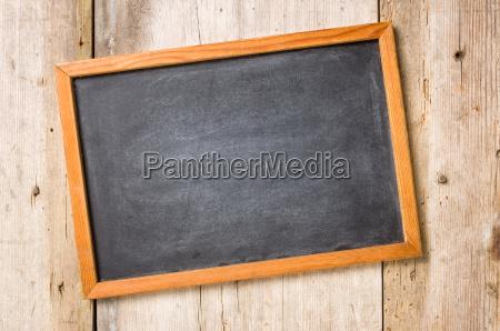 blank blackboard in front of rustic