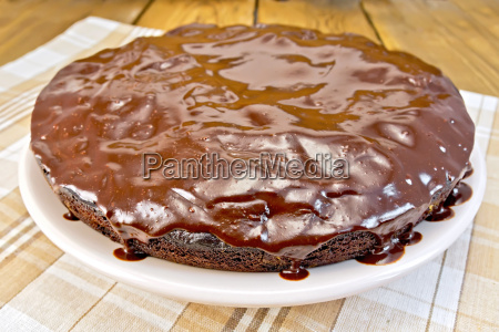 pie chocolate with icing and napkin
