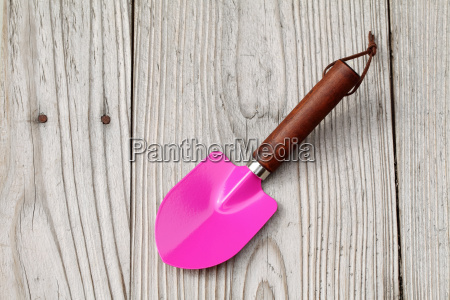 garden shovel on wooden table