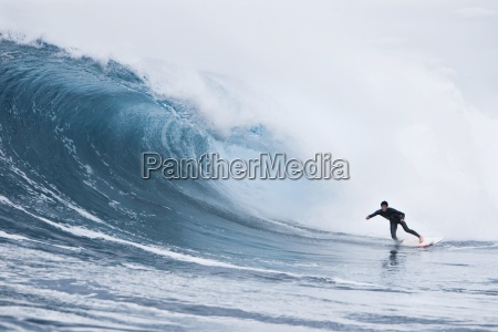 a young man surfing at shipsterns