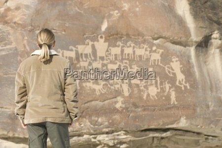 woman looking at pictograph panel