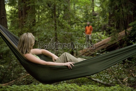 a woman relaxing in a hammock