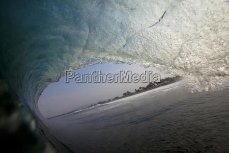 a huge wave barrels at the