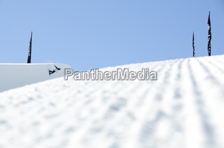 a snowboarder on a half pipe