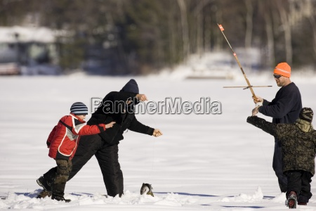 people ice fishing on maine lake