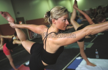 blond woman in a yoga class