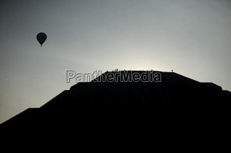 a hot air balloon flies in