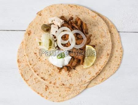 gyros pita with tsatsiki coleslaw olives