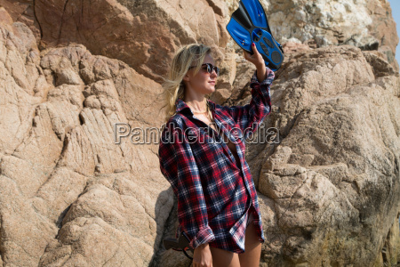 girl with harpoon in flannel shirt