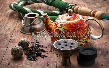 details smoking hookah on background of