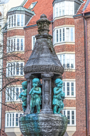 fountain statue with children in the