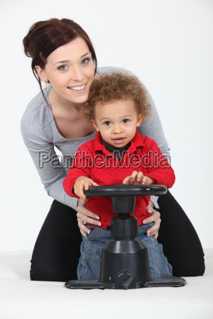 woman and child playing with a
