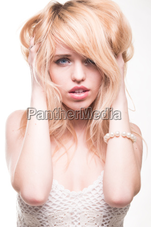 blond, woman, with, hands, in, hair - 14042097
