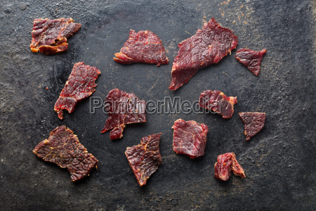 beef, jerky, on, old, black, table - 14044847