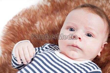 portrait of adorable baby lying on