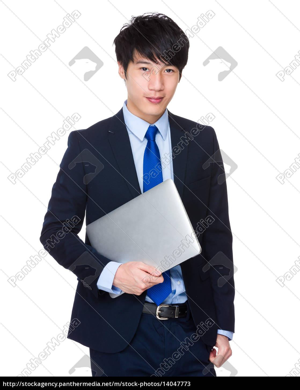 asian, businessman, holding, a, laptop - 14047773