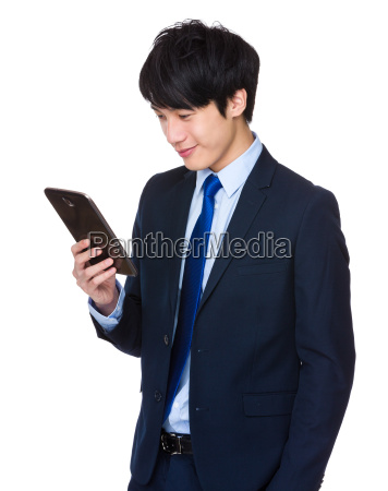 chinese, businessman, with, a, tablet, computer - 14047767