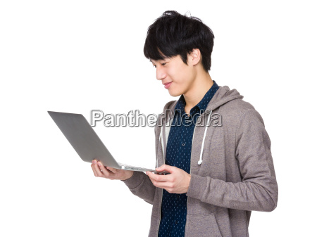 confident, young, man, with, laptop, standing - 14047325
