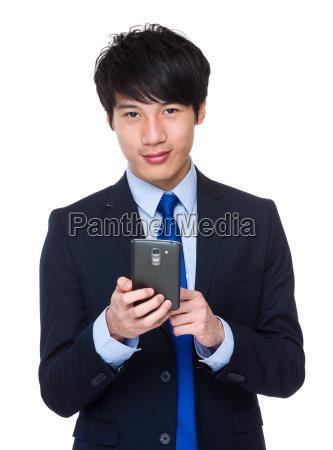 young, asian, businessman, sends, a, text - 14047769