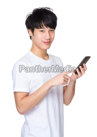 young, asian, man, using, phone - 14047355