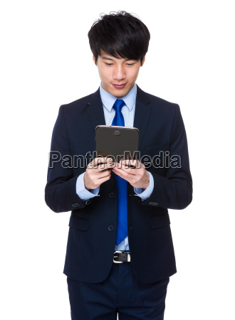 young, business, asian, man, using, his - 14047763