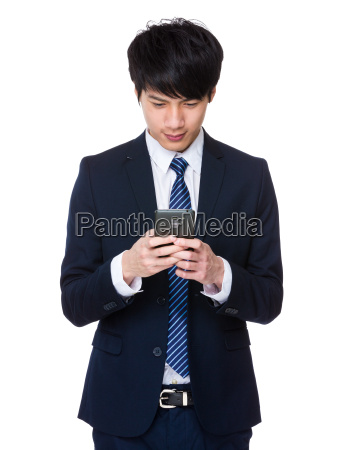 young, businessman, was, writing, a, message - 14047717