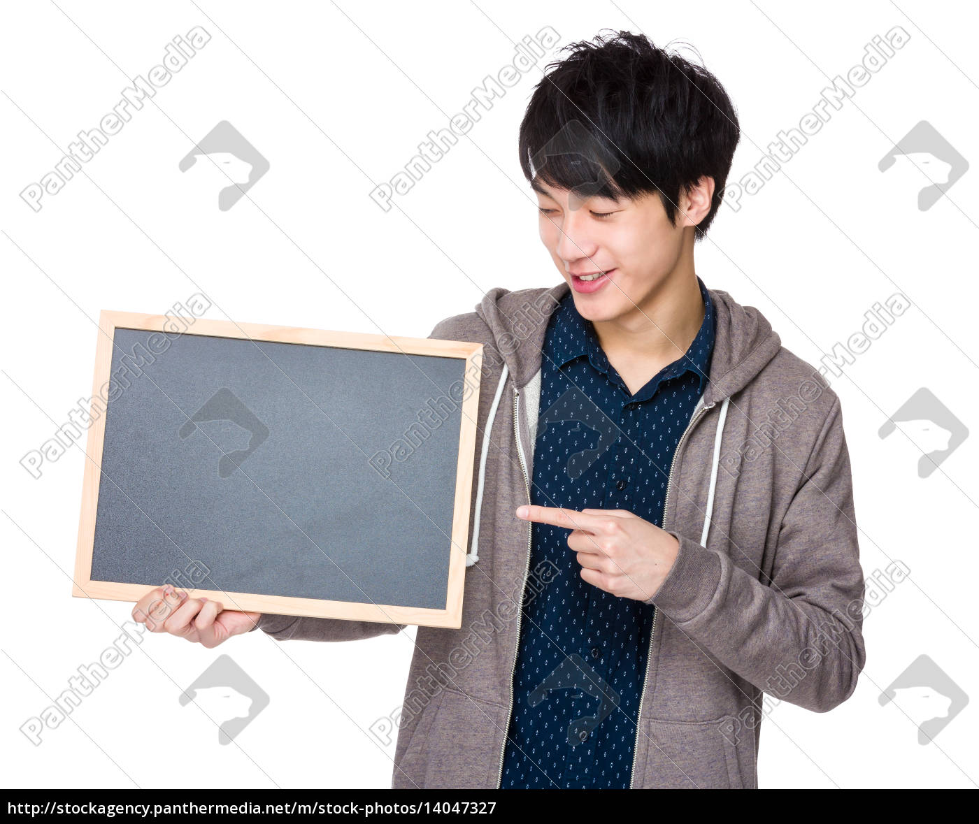 young, man, finger, point, to, chalkboard - 14047327