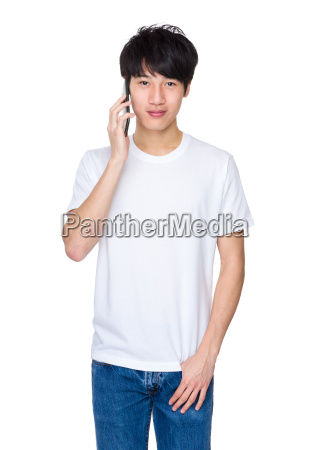 young, man, talking, on, smart, phone - 14047357