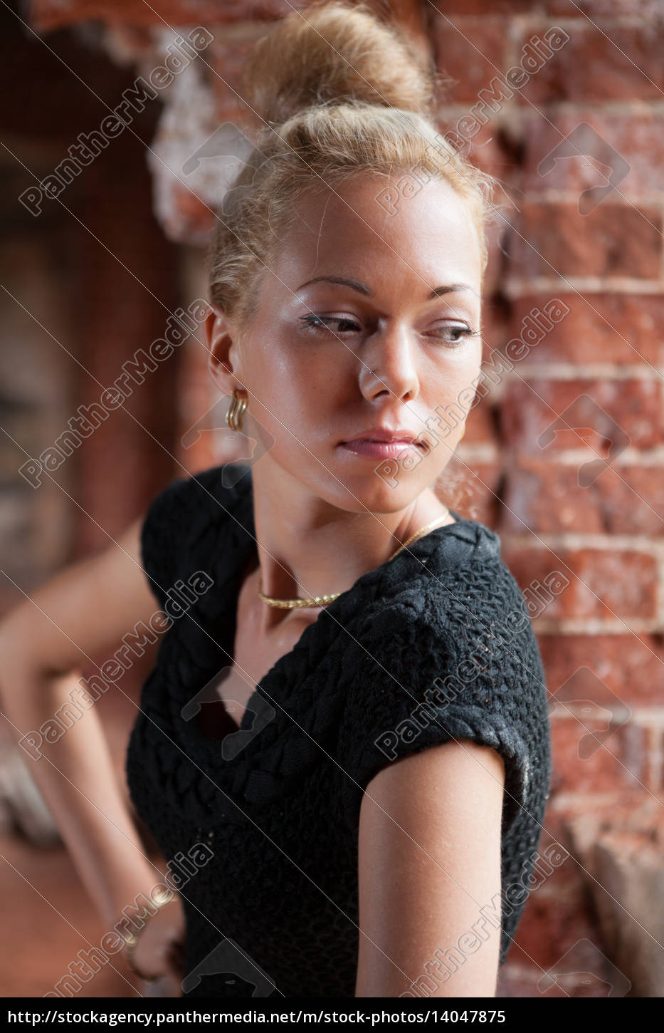 young, women, on, brick, wall, background - 14047875
