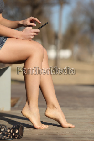 woman, using, a, smart, phone, relaxing - 14051743