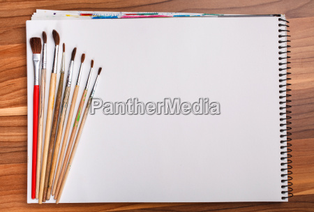 paint and sketch book with brushes