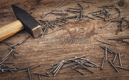 metal hammer and nails on wooden