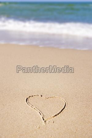 heart in sand on the beach