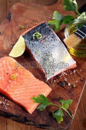 raw salmon fish meat on cutting