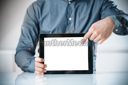 businessman, pointing, to, a, blank, screen - 14053799