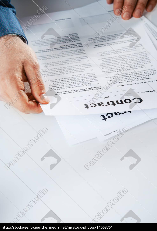 businessman, reading, through, a, contract - 14053751