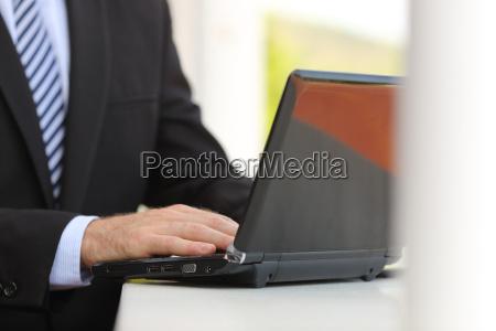 business man hand using a laptop