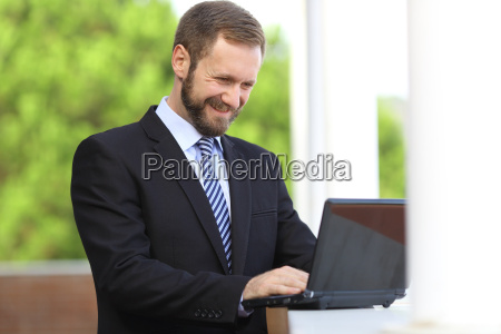happy business man working browsing internet